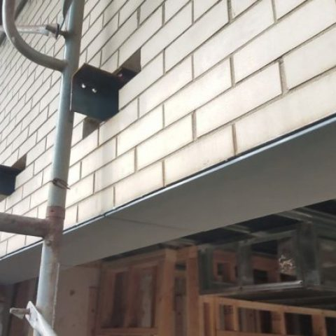 Completed repair – new galvanized brick support (with needle beams above shown prior to removal)
